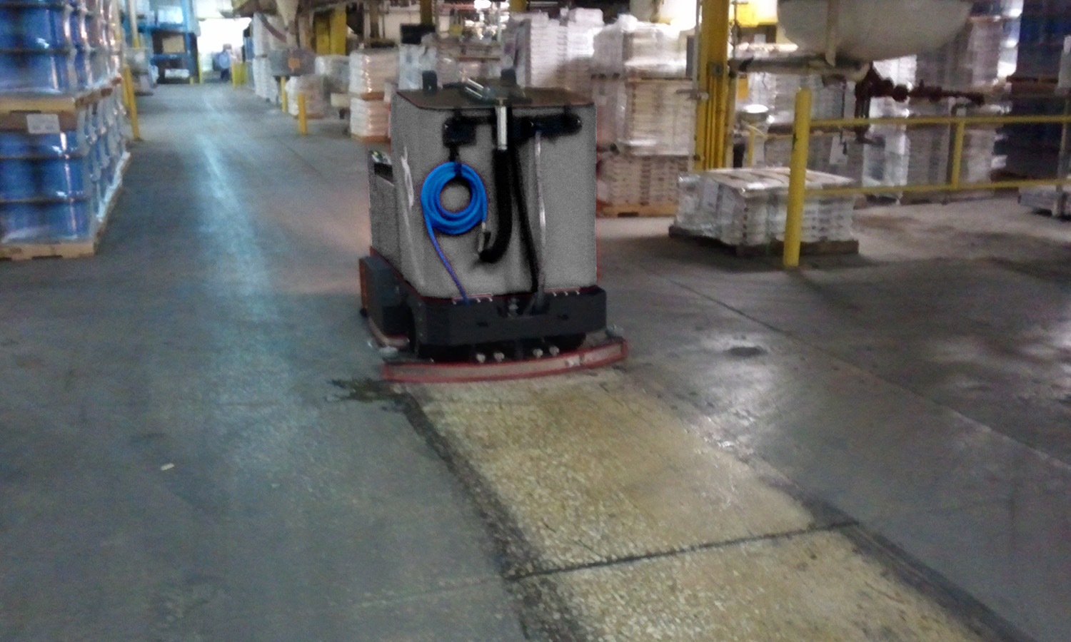 Tomcat Floor Scrubber Demonstration in a Warehouse
