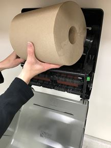 Hardwood Roll Towel being placed into a Pro-Link Auto-Cut Dispenser