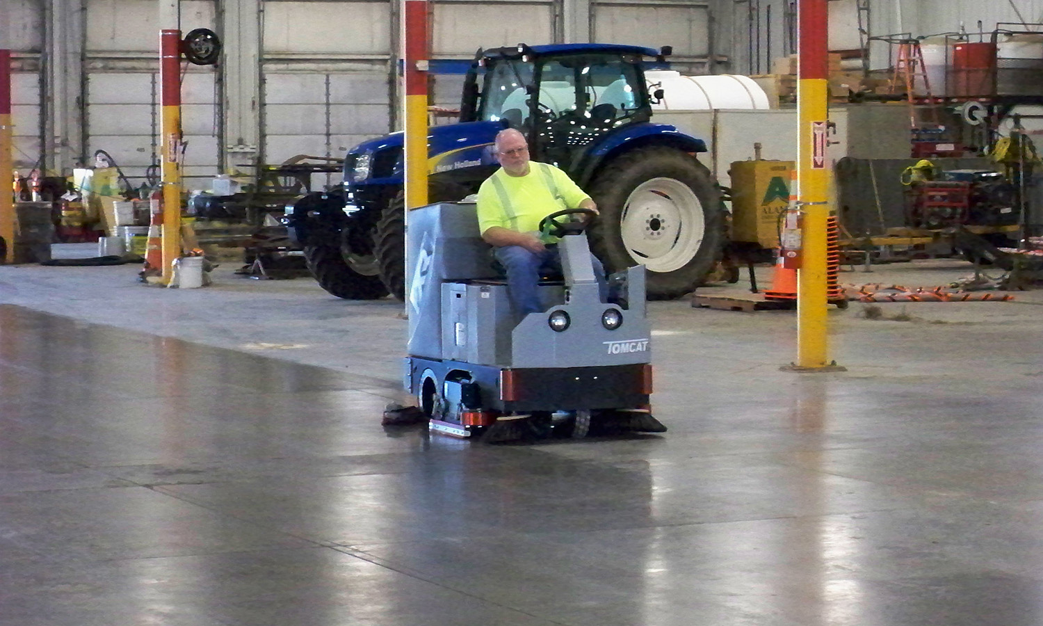 Tomcat Riding Floor Scrubber Demonstration in a Service Bay